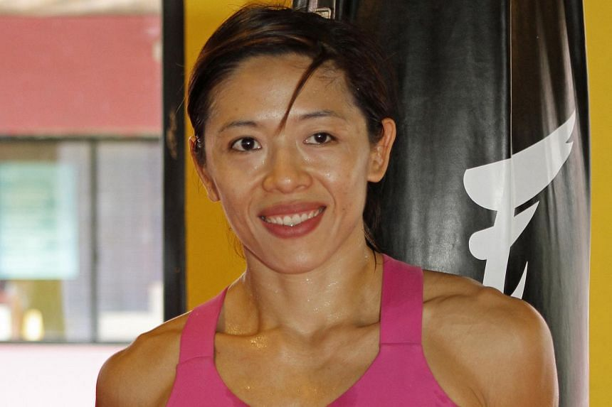 Professional mixed martial arts exponent May Ooi (pictured) fell to Anna Bezhenar of Ukraine at the World Series Of Fighting - Global Championship.