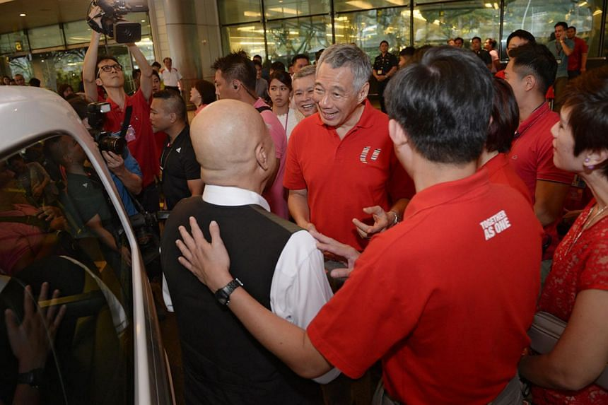 PM Lee Hsien Loong and union leaders greeting taxi drivers at Changi Airport Terminal 2 on Feb 8, 2016.