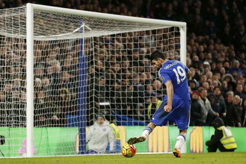 Chelsea's Diego Costa scores their tying goal on Sunday.