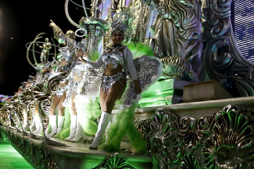Revellers of Grande Rio samba school performing during the carnival parade at the Sambadrome in Rio de Janeiro, on Feb 8, 2016.
