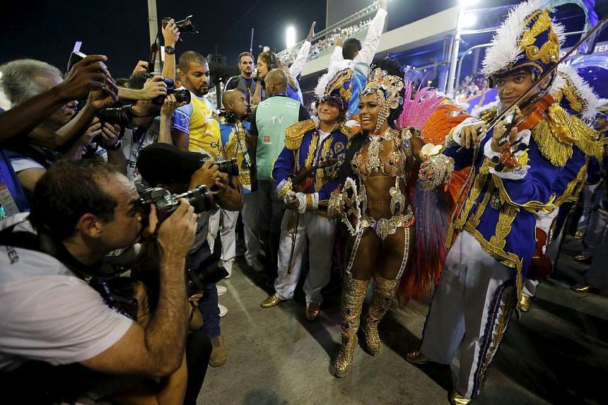 Beija-Flor samba school's Drum Queen Rayssa Oliveira (second right) performing during the carnival parade at the Sambadrome in Rio de Janeiro.