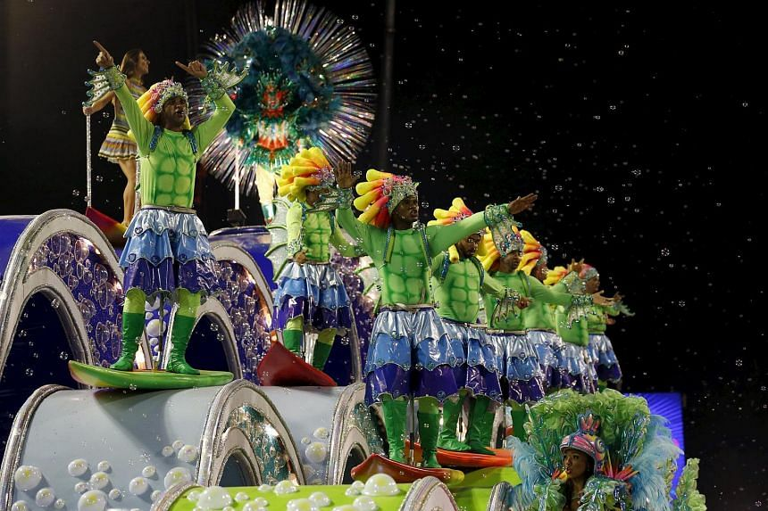 Revellers of Uniao da Ilha samba school performing during the carnival parade on Feb 7, 2016.
