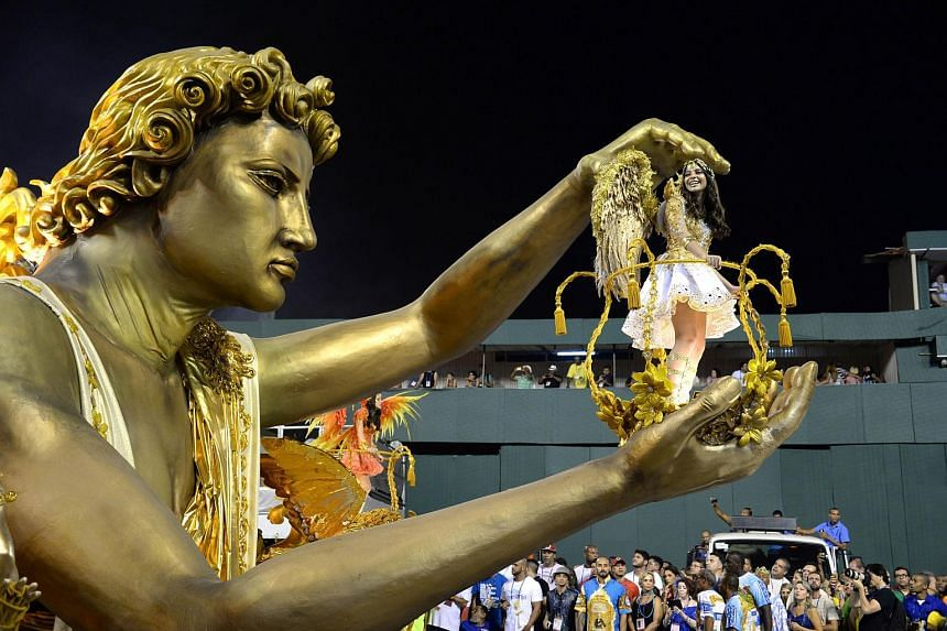 Revellers of Beija-Flor samba school performing during the first night of the carnival parade at Sambadrome in Rio de Janeiro.