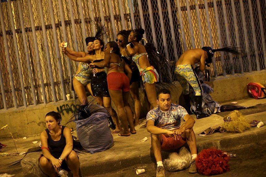Revellers of the Estacio de Sa samba school leaving the Sambadrome after parading in the carnival in Rio de Janeiro.