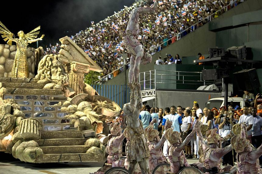 Revellers of Uniao da Ilha do Governador samba school performing during the first night of the carnival parade.