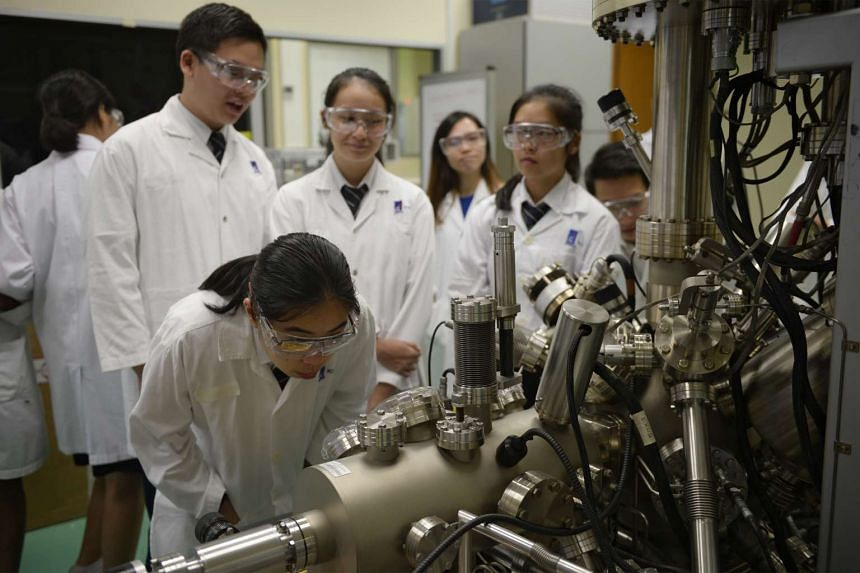 St Andrew's Junior College students observing X-ray photoelectron spectroscopy on a visit to the Institute of Chemical and Engineering Sciences in Jurong last November. JC students will be taught to relate abstract concepts to real-world examples and