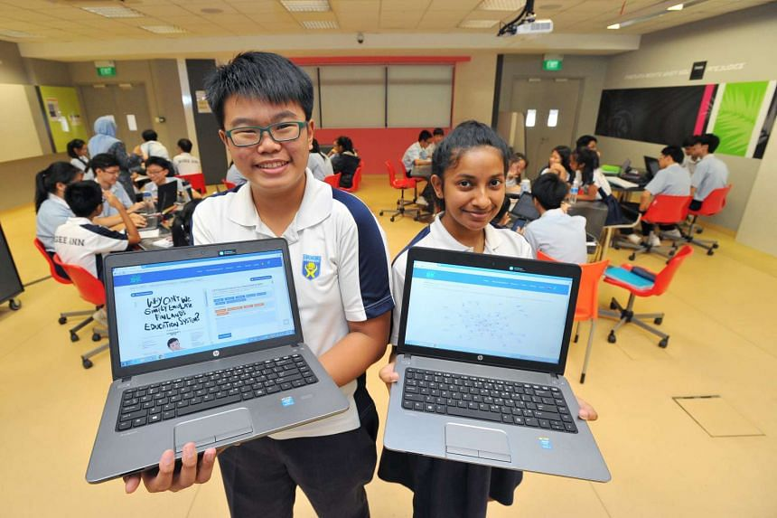 Ngee Ann Secondary students Sean Lam (left) and Maya Sri Dewi were part of the Web-based reading and learning analytics programme last year.