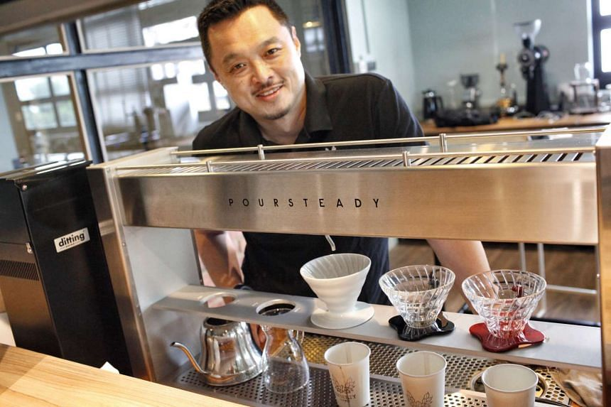 Liberty Coffee's Terence Tay with the automated Poursteady station.