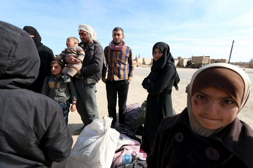 Internally displaced Syrians who fled from Aleppo arrive in the village of Mabrouka, Syria.