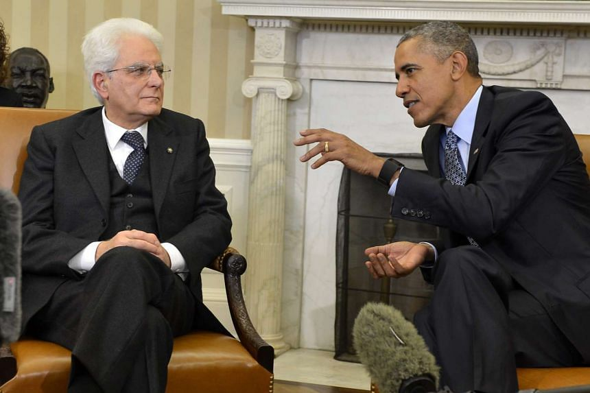 US President Barack Obama (right) chats with Italian President Sergio Mattarella, prior to remarks to the press, after a bilateral meeting in the Oval Office of the White House, in Washington, DC, USA, on Feb 8, 2016.