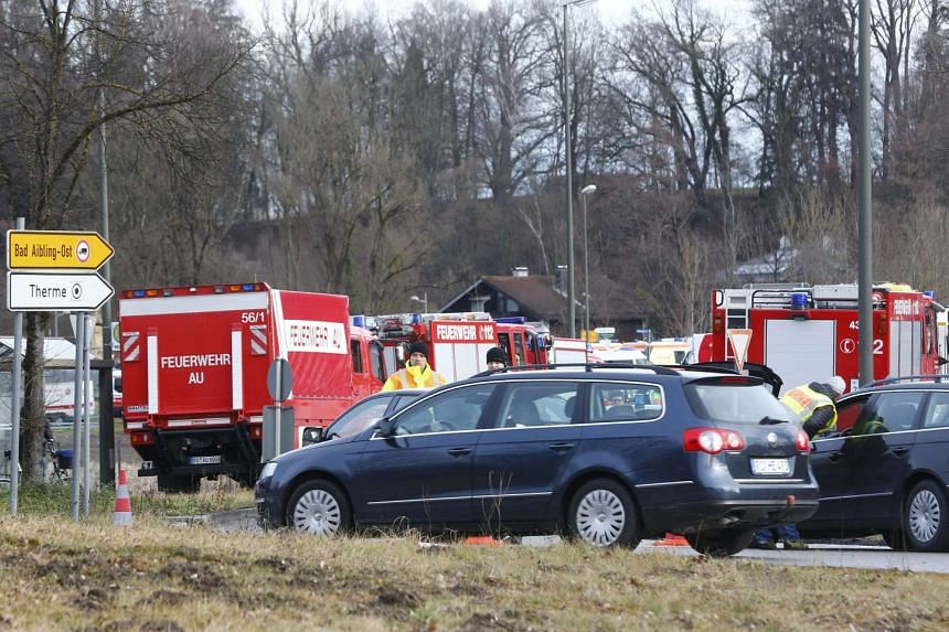 Cars of firefighters parked near Bad Aibling in southwestern Germany on Feb 9, 2016.