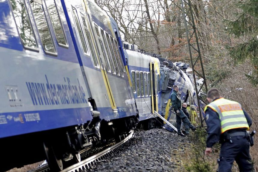 Rescue teams work at the site of a train accident near Bad Aibling, Germany on Feb 9, 2016.