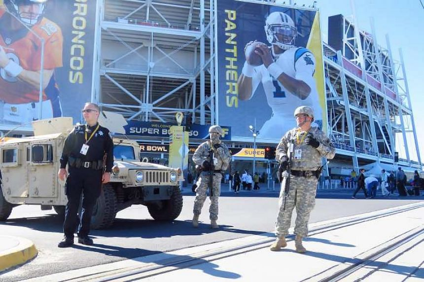 Police and military security patrolling several hours before the start of the NFL's Super Bowl 50 on Feb 7, 2016.