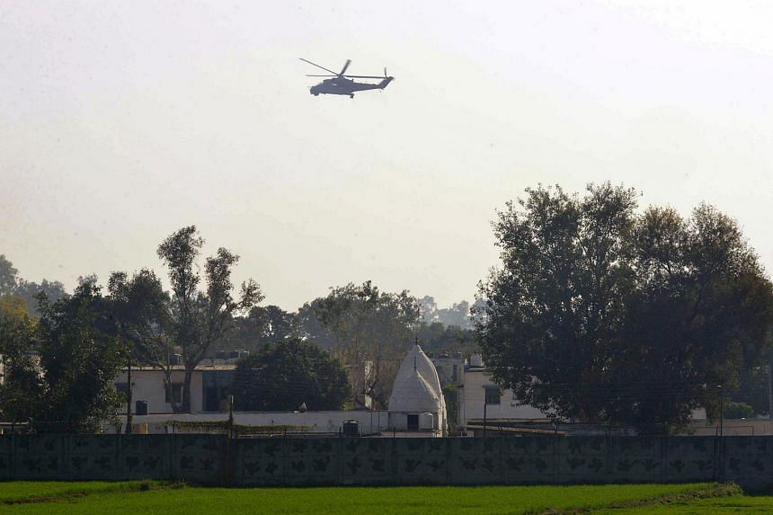 An Indian Air Force helicopter flies over an airforce base in Pathankot on Jan 2, 2016.