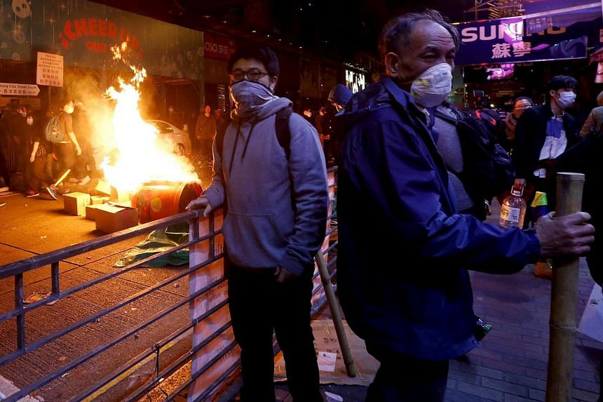 Protesters setting fire at a junction at Mongkok shopping district in Hong Kong, China on Feb 9, 2016.