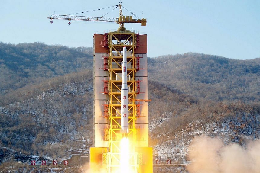 A North Korean long-range rocket is launched into the air at the Sohae rocket launch site, North Korea, in this photo released by Kyodo on Feb 7, 2016.