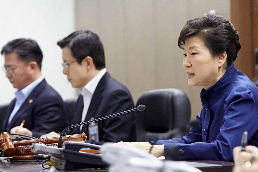 South Korean President Park Geun Hye (right) presiding over the National Security Council at the Presidential Blue House in Seoul.