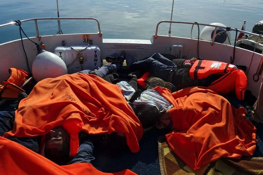 Drowned bodies are seen on the back of a Turkish Coast Guard boat on Monday after refugees, including children, failed to sail to the Greek islands.