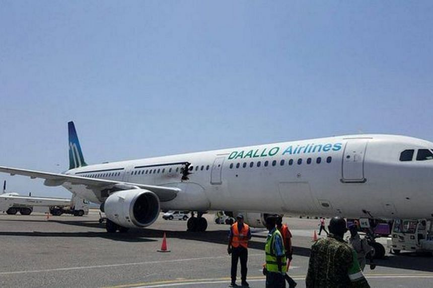 The damaged passenger plane taxis at the airport in Mogadishu, Somalia on Feb 2.