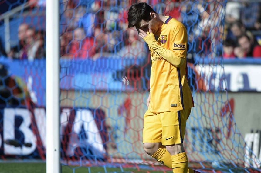 Lionel Messi gestures after missing an attempt on goal on Sunday.
