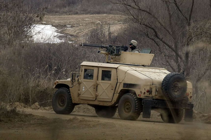 A US soldier stands atop a military humvee at a training ground in Paju on Monday, a day after North Korea's long-range rocket launch.
