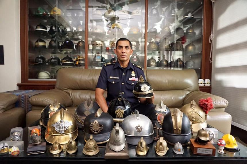 Senior Warrant Officer Junaidi Rowden with his collection of firefighting memorabilia.