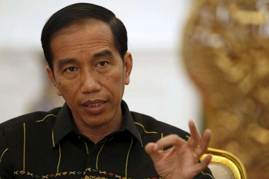 Indonesian President Joko Widodo gestures during an interview at the presidential palace in Jakarta, Indonesia, Feb 10, 2016.