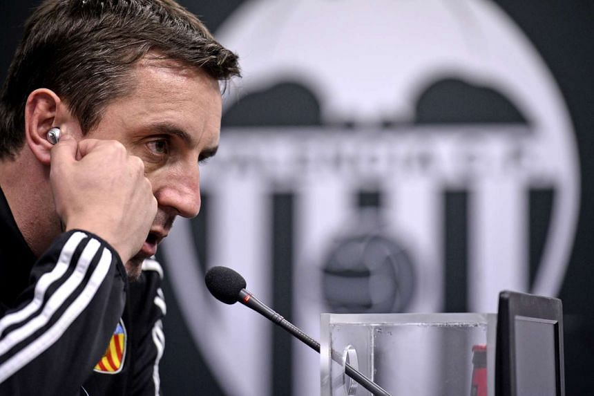 Gary Neville speaks during a press conference at the Sports City in Valencia.