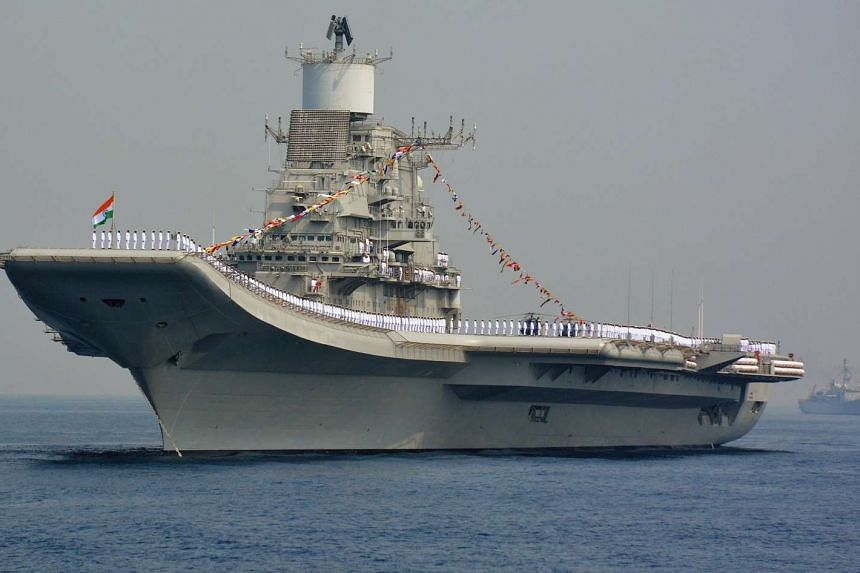 Indian Navy personnel stand on the INS Vikramaditya, a modified Kiev-class aircraft carrier on Feb 6, 2016.