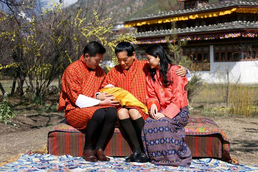 From left: King Jigme Namgyel Wangchuck, his father the former king Jigme Singye Wangchuck, and Queen Jetsun Pema sit with the royal baby Gyalsey at Bhutan's Lingkana Palace.