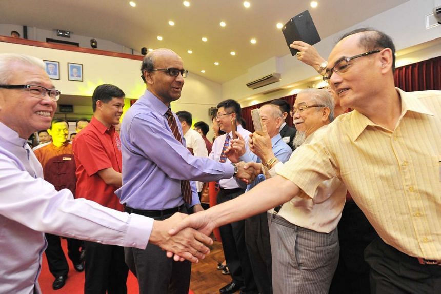 DPM Tharman (centre) meeting guests at a Chinese New Year reception organised by the SFCCA, Business China and the Singapore Chinese Cultural Centre.
