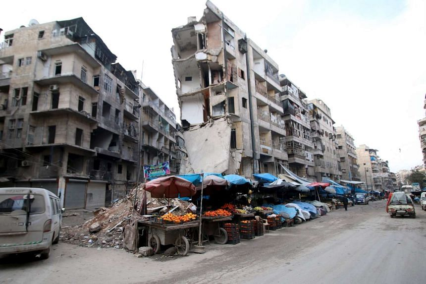 Stalls are seen on a street beside damaged buildings in the rebel held al-Shaar neighborhood of Aleppo, Syria.