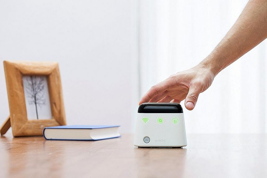 The Ambi Climate unit stands upright, its wide base allowing it to sit neatly on a table top.