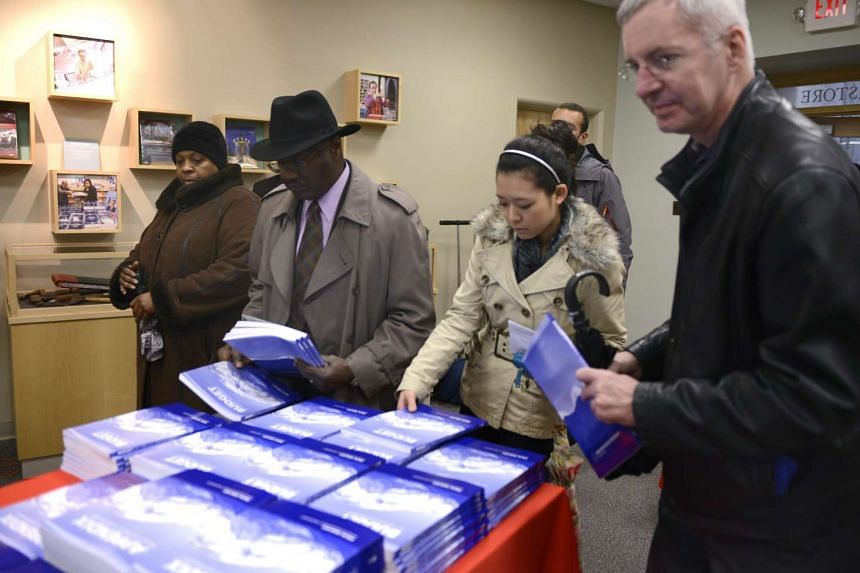 Customers snap up copies of Obama's Fiscal Year 2017 budget as they go on sale in Washington, DC.