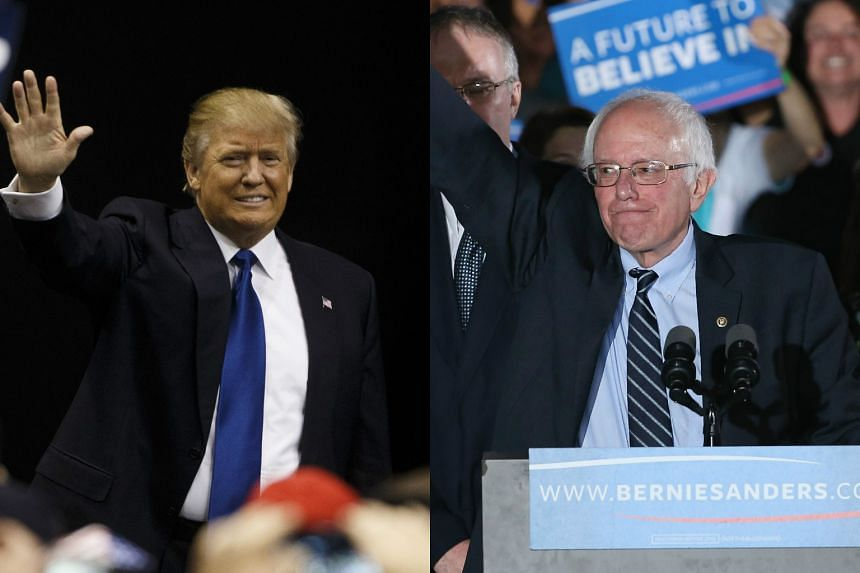 Donald Trump (left) and Bernie Sanders decisively won Tuesday's (Feb 9) presidential primaries in New Hampshire.
