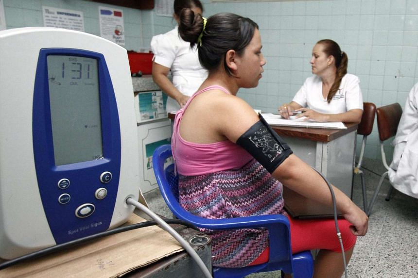 A pregnant patient undergoes tests in Colombia after suffering from fever and skin rash.