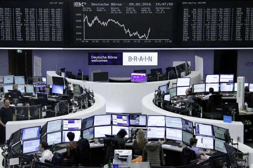 Traders work in front of the German DAX board at the stock exchange in Frankfurt, Germany, Feb 9, 2016.