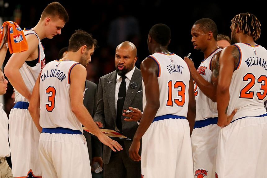 Former coach of the New York Knicks, Derek Fisher (centre) talks with his team during a time out in the fourth quarter against the Philadelphia 76ers.