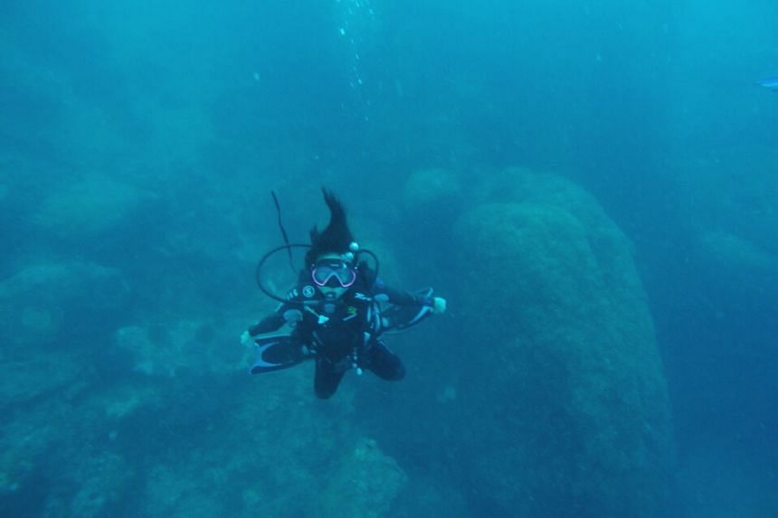 Environment reporter Audrey Tan on a diving expedition in Bali.