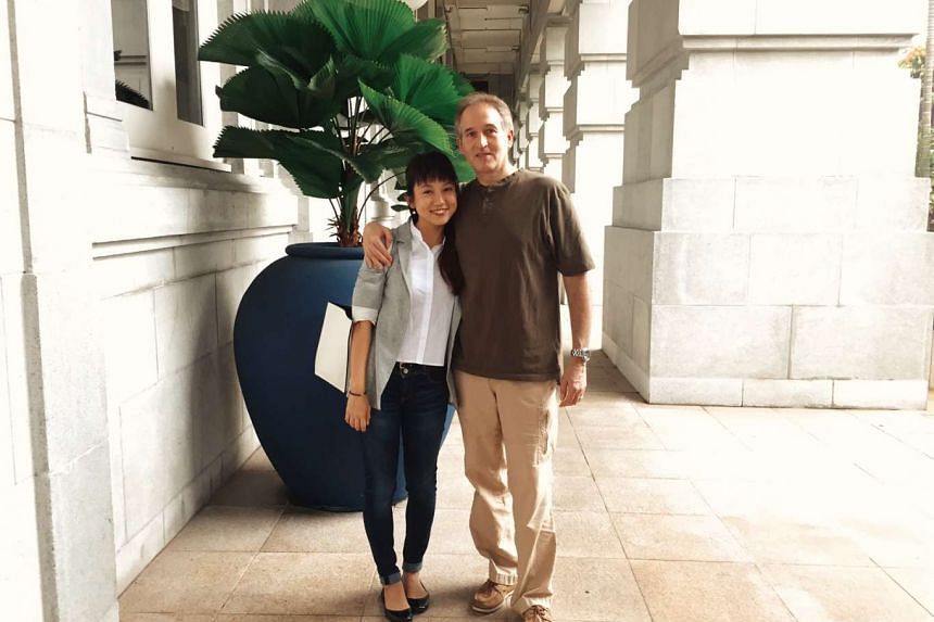 Environment reporter Audrey Tan with National Geographic marine photographer and marine conservationist Brian Skerry, whom she interviewed.