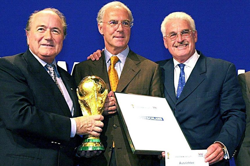 A file picture dated July 6, 2000 of Joseph Blatter (left), Franz Beckenbauer (centre) and Fedor Radmann, posing for photographers in Zurich, Switzerland.