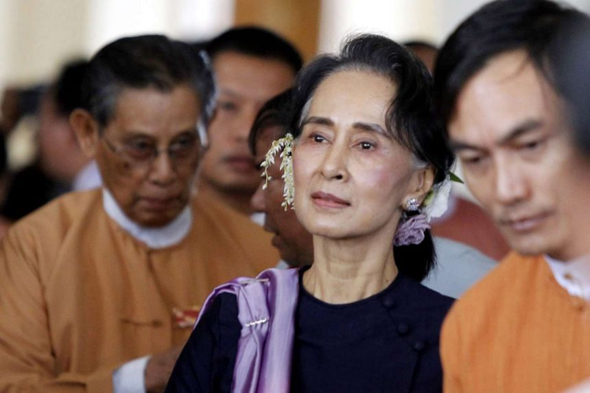 Myanmar National League for Democracy leader Aung San Suu Kyi leaves after attending the upper house parliament session in Naypyitaw, on Feb 3, 2016.