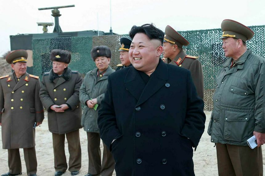 North Korean leader Kim Jong-un observes a multiple-rocket launching drill in North Korea.