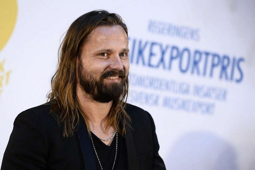 Max Martin smiles during an export prize ceremony in Stockholm.