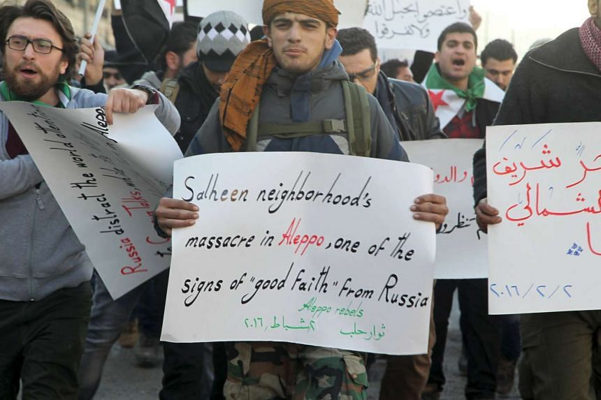 Protesters demonstrate against Russian air strikes and an offensive by government-allied forces on Aleppo.