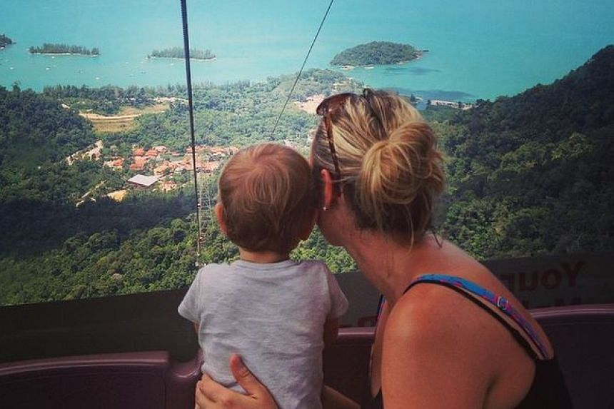 Ms Edwards and Esme on the cable car in Langkawi.
