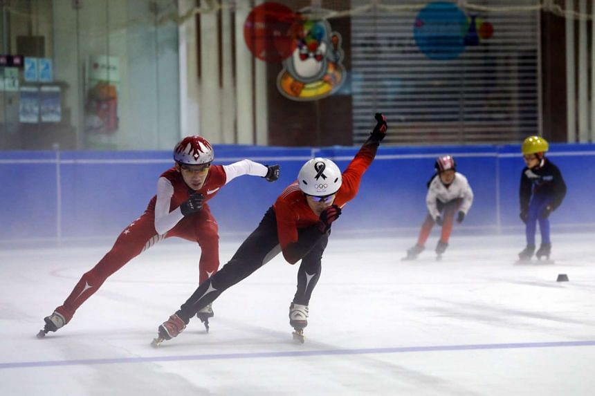 Short-track speed skaters Lucas Ng (second from left) and Matthew Mak in action at JCube Ice Rink.