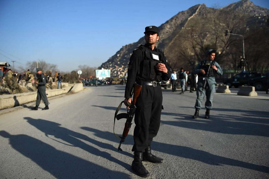 Afghan security personnel standing guard outside a police base in Kabul on Feb 1, 2016.