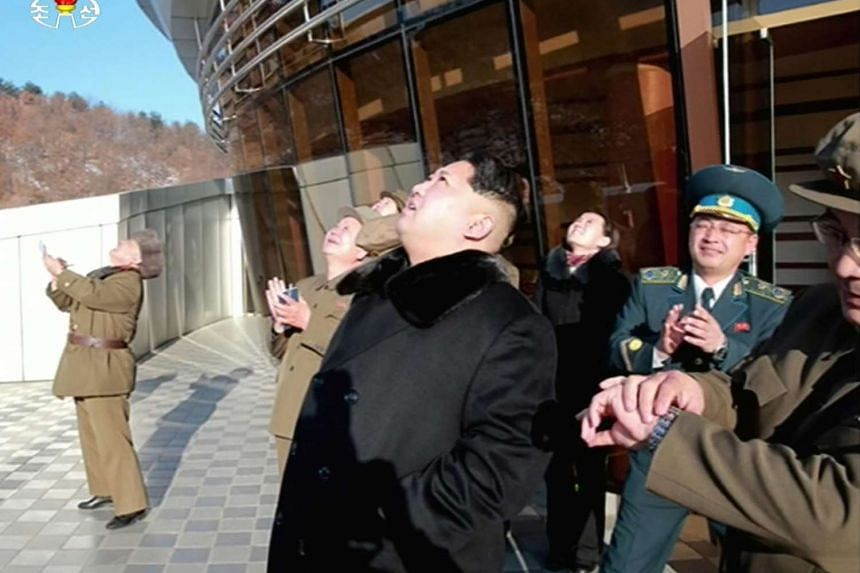 This picture taken from North Korean TV and released by South Korean news agency Yonhap on Feb 7, 2016 shows North Korean leader Kim Jong Un looking at the locket launch of earth observation satellite Kwangmyong 4. North Korea said on Feb 7 that it