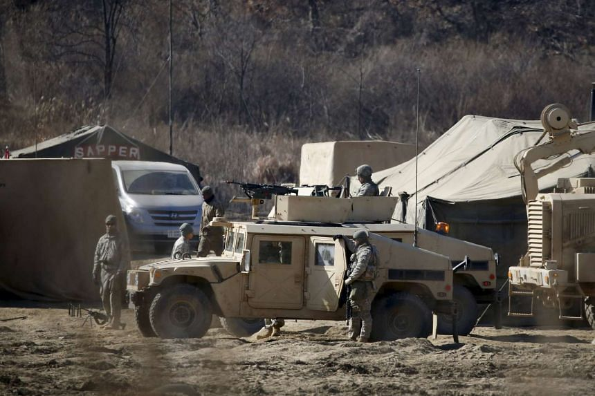 US army soldiers take part in a military exercise near the demilitarised zone separating the two Koreas in Paju on Feb 7, 2016.